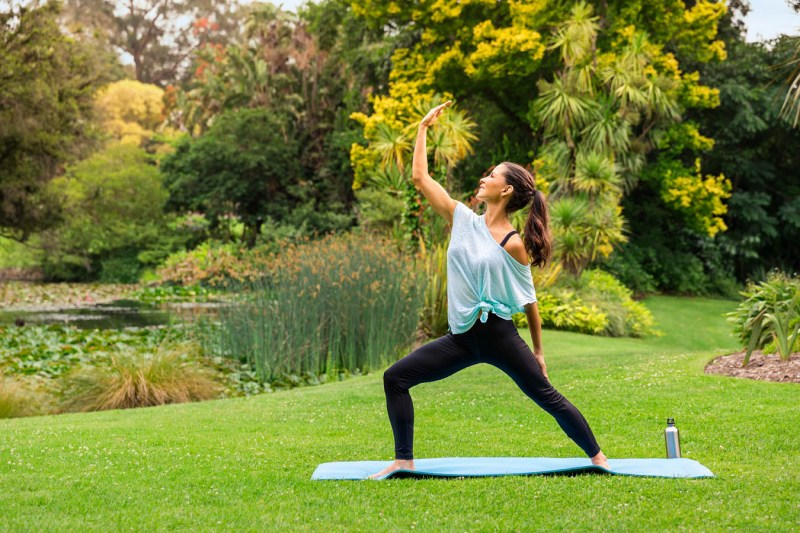 woman doing yoga in a green park in Melbourne Australia