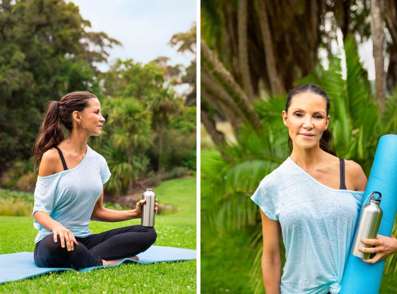 Woman in a park with yoga mat and water bottle