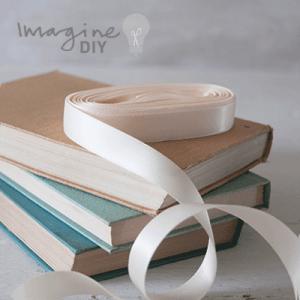 cream satin ribbon. Roll of narrow double faced satin ribbon. 13mm. DIY wedding stationery supplies