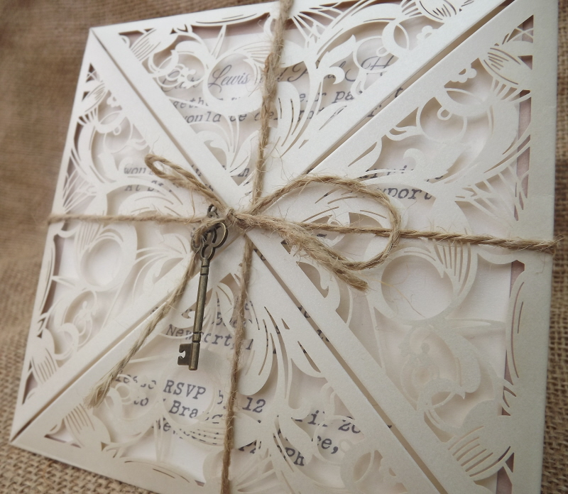 pretty laser cut invitation with shabby chic details. Made by Anna Carter of Cardiff Invitations
