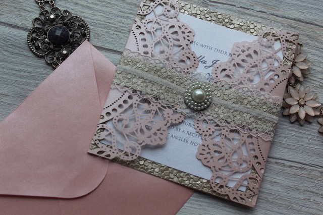 pretty wedding invitation in gold and blush pink. Pearl embellishment