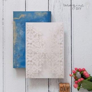 Sansa Winter Laser Cut Range - White. White winter lasercut wedding invitation.