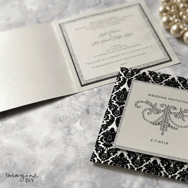 diy wedding invitation. Black, white and silver wedding ideas. Glamorous DIY wedding invitation with damask flock and crystal decorations