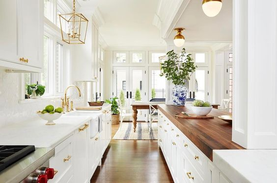 Beautiful Kitchen Inspiration with white cabinets and gold accents and hardware from Amie Corley Interiors