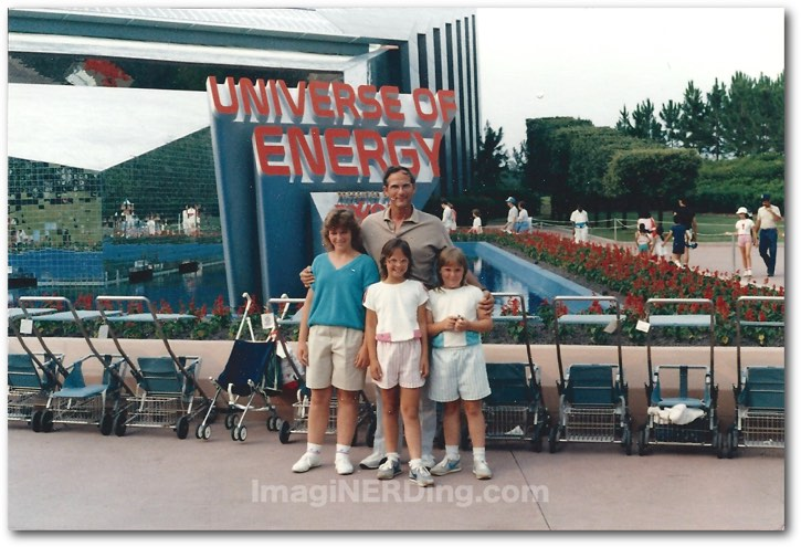 image from 1985 showing the Universe of Energy sign at EPCOT and several strollers