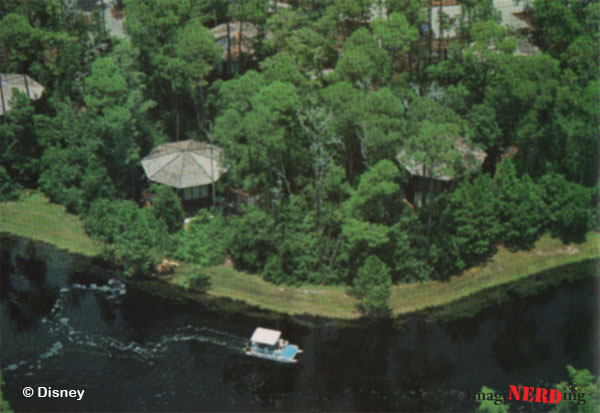 Treehouse Villas at Lake Buena Vista seen from above with a boat passing by on the river.