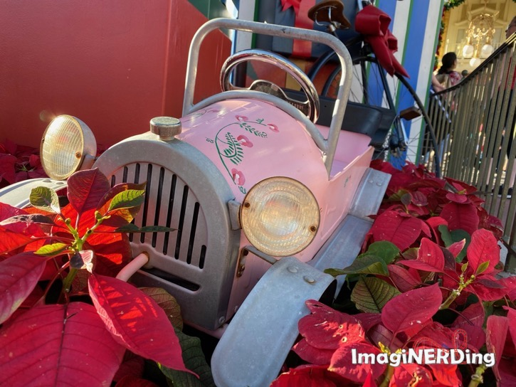 close up of one of the children's toy vehicle undertake christmas tree a the magic kingdom