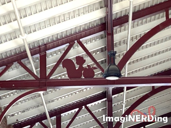 steel cutout of a squirrel in the disney market building at disney springs