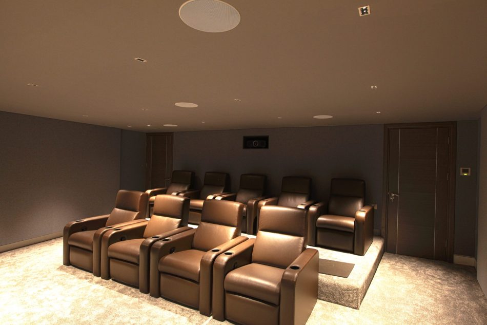 View to rear of immersive home cinema, shows Fortress seating and Barco projector.