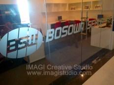 Sticker Sandblast Logo Bosowa Sekuritas di Menara Bosowa Makassar