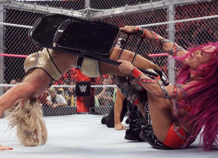 Sasha hits Charlotte with a chair during the Figure 8