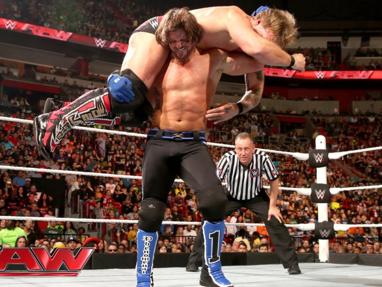 AJ Styles holds Chris Jericho on his shoulders