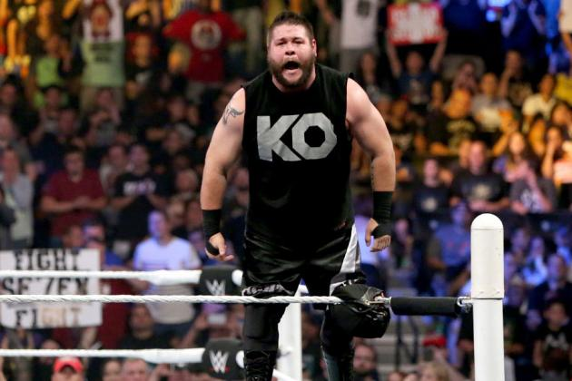 Kevin Owens stands on the turnbuckle