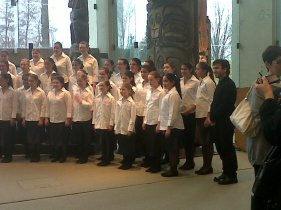 Iman Habibi and BC Girls' Choir after the performance of Lullaby of Hiroshima at the Museum of Anthropology