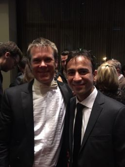 Iman Habibi and conductor Alexander Micklethwaite following the Winnipeg Symphony Orchestra's performance of Habibi's The Promised Hand