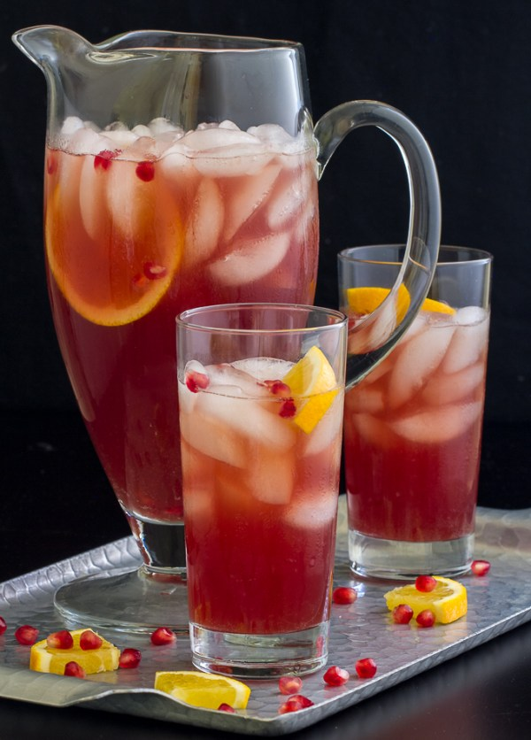 These Spiced Pomegranate Pitcher Cocktails are perfect for holiday parties!