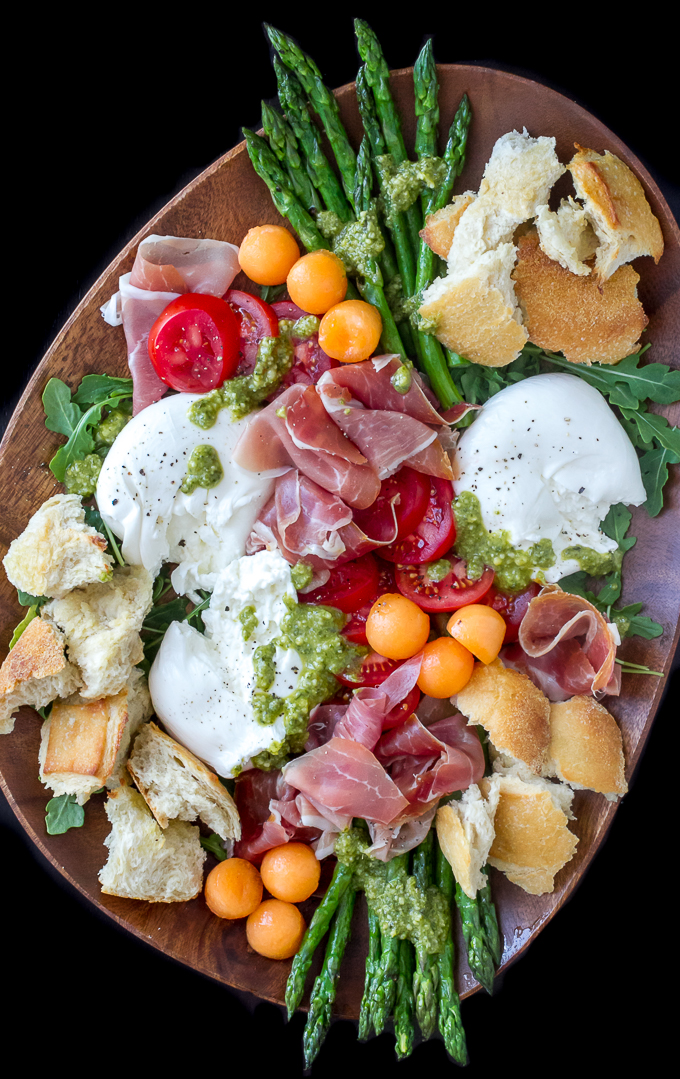 Prosciutto Burrata Asparagus Salad with melon, tomatoes, arugula & pesto. Perfect as a salad or antipasto appetizer platter.