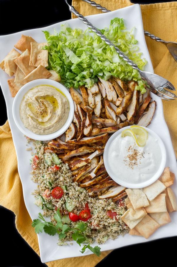 Chicken Shawarma salad platter with tabbouleh, hummus, garlic sauce