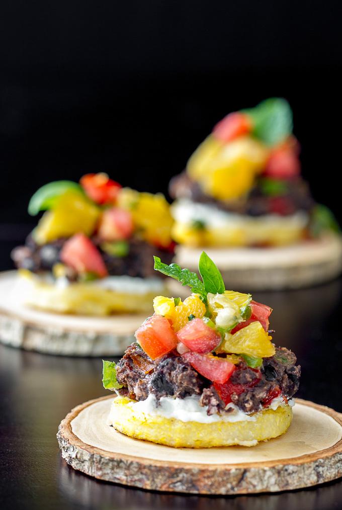 Crispy Polenta topped with Black Bean Cake, Goat Cheese & Orange Basil Mint Salsa