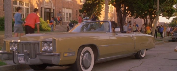 A yellow car parked outside of the high school. The coolest of the cars in Never Been Kissed