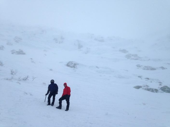 Self-arrest techniques at the base of a stormy Tuckerman Ravine on Mount Washington.