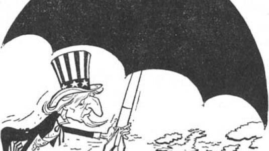 Αμερικανική γελοιγραφία του 1947. Παρουσιάζει το μπάρμπα Σαμ να προσφέρει ομπρέλα προστάσίας στην Ευρώπη. Η ομπρέλα, όμως, κρύβει μια βόμβα...