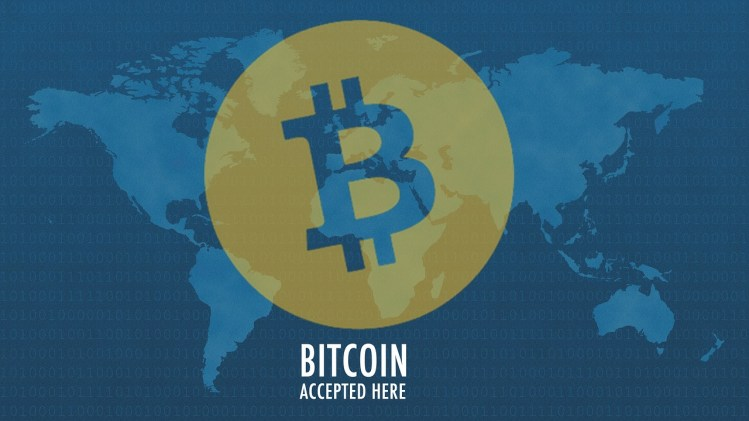 picture of Bitcoin icon over blue world map