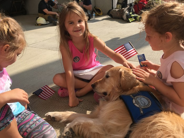 Louie Comfort Dog visiting with children