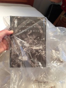 Hardback in a plastic bag.