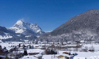 kirchdorf-winter-mit-wild.kaiser