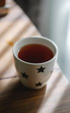 hot tea in cup on table