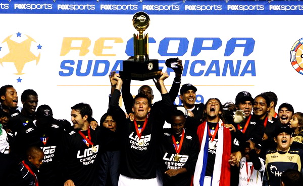 Ecuador's LDU Quito soccer players raise cup after winning final soccer match of Recopa Sudamericana against Brazil's Internacional in Quito