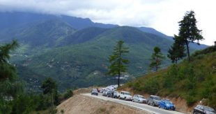 Vehicles lined up near the newly-completed Giant Buddha stupa in Thimphu, Bhutan [Image: Dawa Gyelmo]