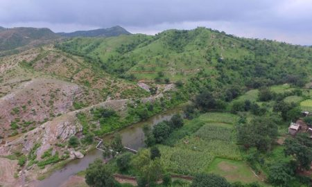 Degraded land, with parts restored by villagers working with the Watershed Organisation Trust [Image by: WOTR]
