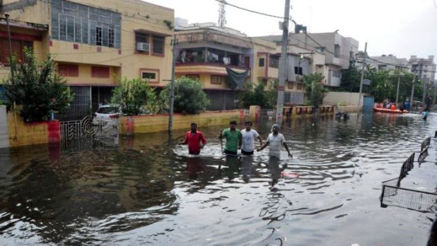 In many parts of the city the water still remains stagnant in the streets [image by: Prashant Ravi]