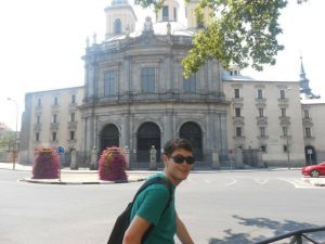 Outside the basilica San Francisco, the boyfriend poses...