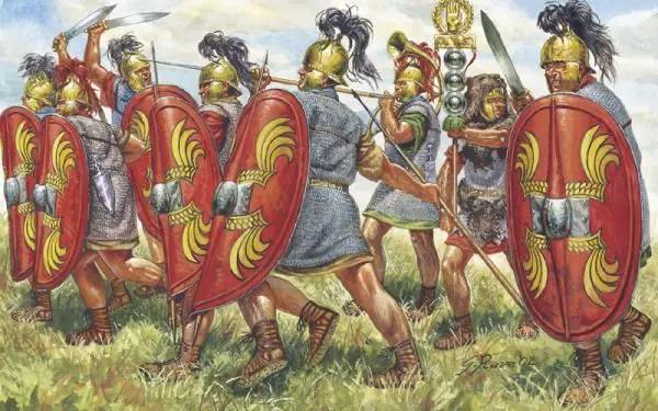 Antesignanos romanos luchando por delante del estandarte y protegiéndolo del enemigo.