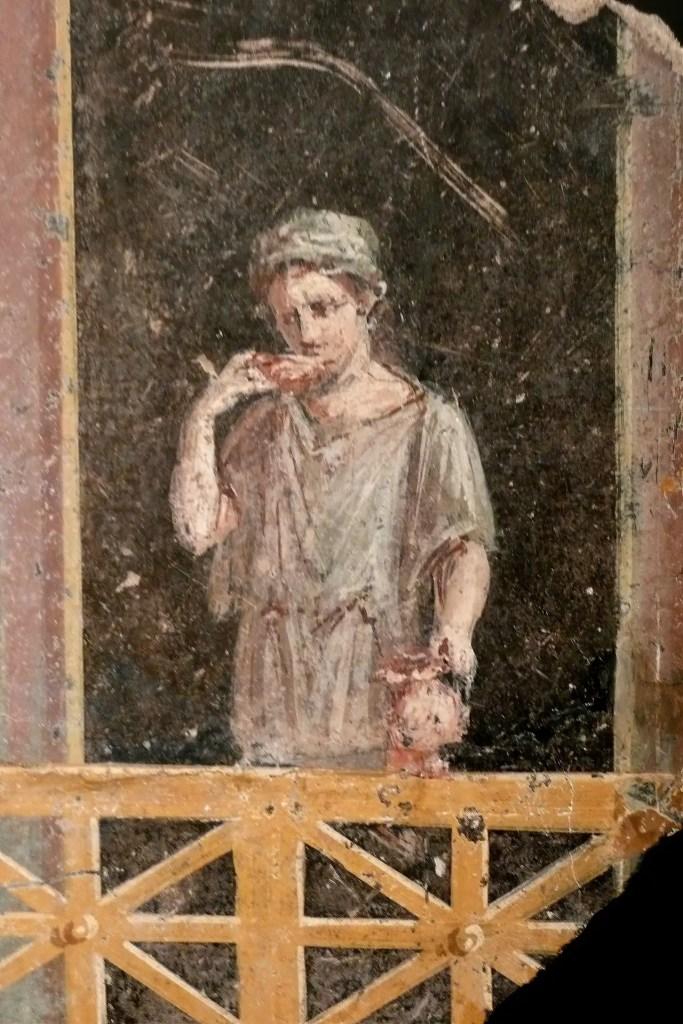 Fresco de una joven mujer romana vestida para las tareas del día a día.