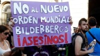"Spanish translation: ""NO TO THE NEW WORLD ORDER BILDERBERGS ASSASSINS!"""