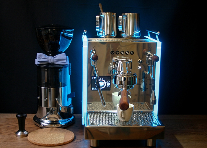 Espresso bar setup with dark background and glowing espresso machine