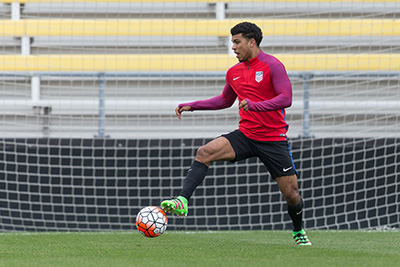 Columbus, OH - March 28, 2016: Controversial, Deandre Yedlin, takes a 'first touch' on the ball to set up for a pass.