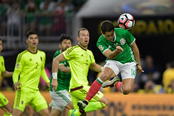 "Javier ""Chicharito"" Hernandez trys for a header during the Mexico and Venezuela Match on June 13, 2016 in Houston, TX."