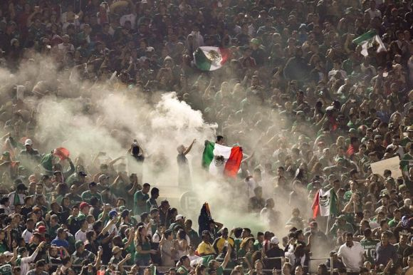 Mexican fans celebrate victory. Photo by Dave Bernal.