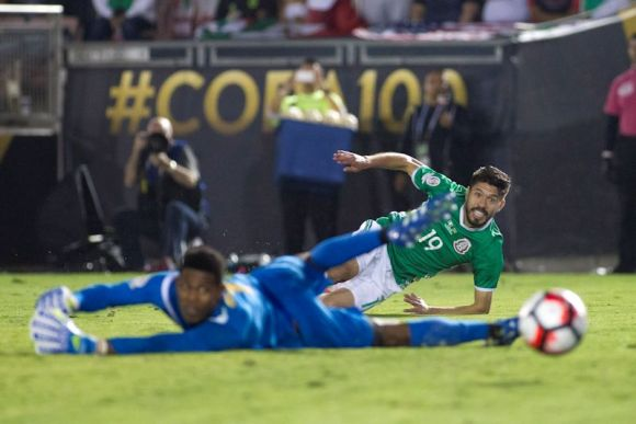 Mexican footballer, Oribe Peralta (19) fires one into the net as Mexico beats Jamaica 2 - 0. Photo by Victor Posadas.