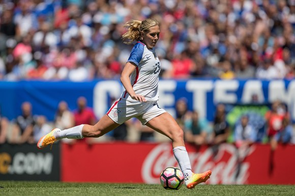 Allie Long sets up for a long ball during the USWNT match against South Africa on July 9, 2016 at Soldier Field in Chicago. The US defeated South Africa 1 - 0. Photo by Robin Alam.