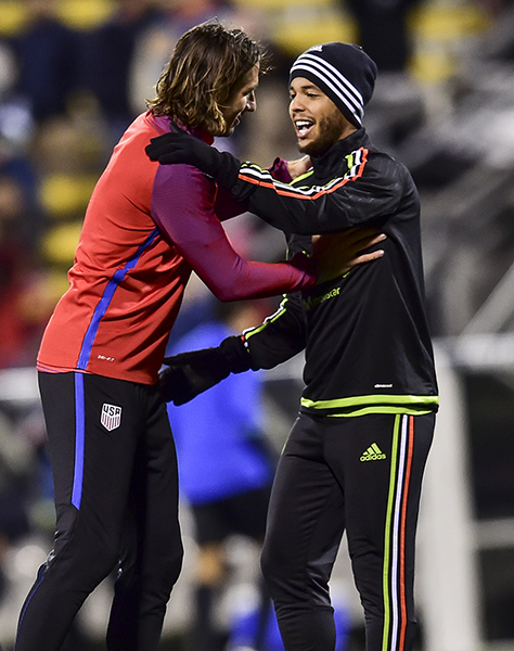 "Alan Gordon (L) and Giovani Dos Santos (R) say a warm ""hello"" prior to KO in Columbus, OH on November 11, 2016.  Photo by Brad Smith."