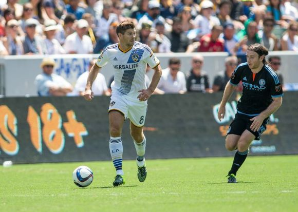 Steven Gerrard of the LA Galaxy (white) looks to cross the ball at Stub Hub Center in Carson, Calif. on August 23, 2015. Galaxy defeated New York City FC, 5 - 1. Photo by Michael Janosz