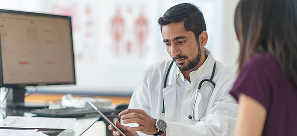 medical professional looking at tablet