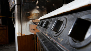 Soot covered stove and refrigerator after a house fire