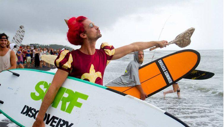 Surfing in costume of Queen Of Hearts